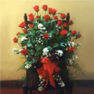 bunch of roses, arranged flowers, floral arrangements with stuffed toys and balloons